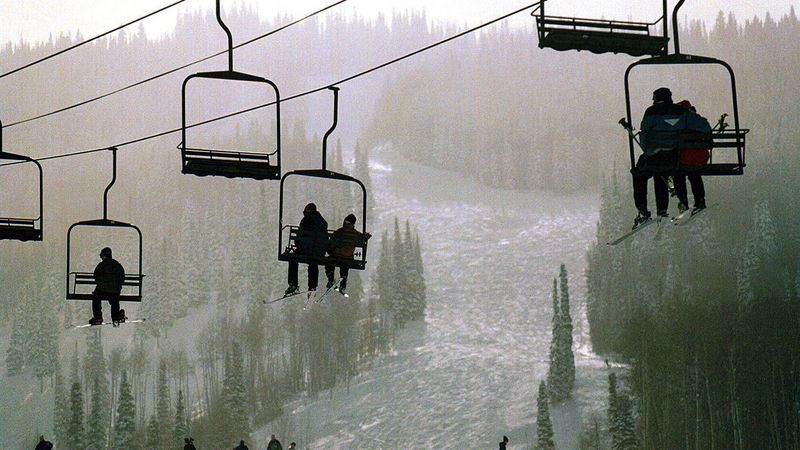 Skiers ride ski lift, Sunlight Mountain Resort, Glenwood Springs, Colorado,