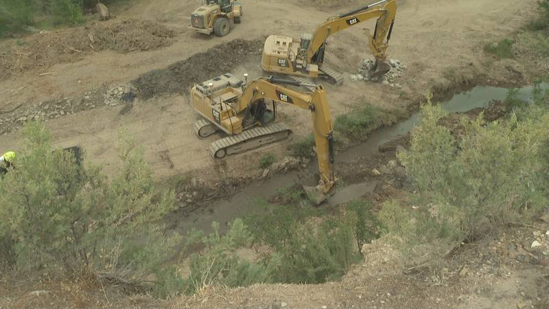 Contractors are currently working on the mitigation efforts along the creek in De Beque, Colo.