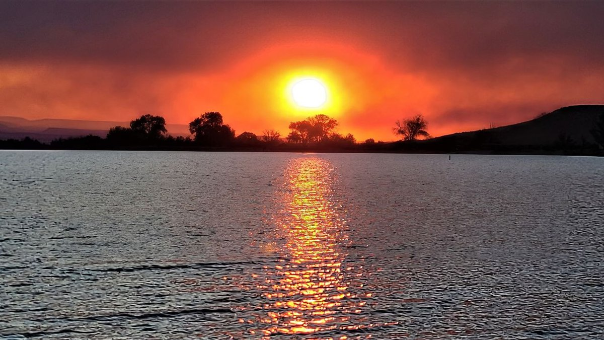 Photo captured near Delta. Smoke from the Pack Creek Fire has caused many beautiful sunsets...