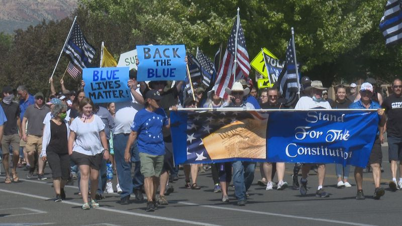 The community marches to show support of police officers