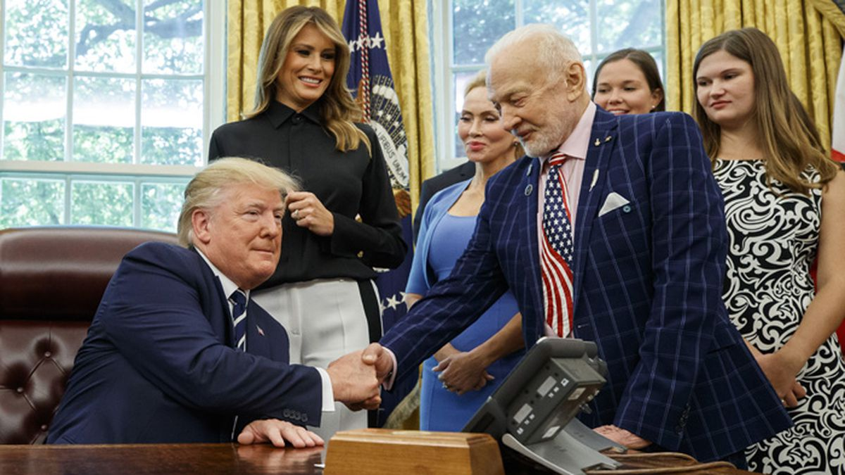 President Donald Trump shakes hands with Apollo 11 astronaut Buzz Aldrin, with first lady...