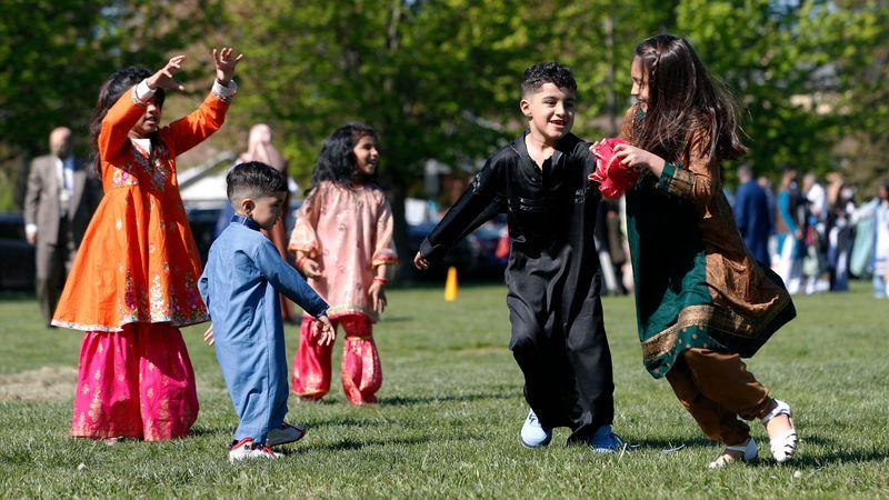 Muslim children plays in an outdoor open area after performing an Eid al-Fitr prayer marking...