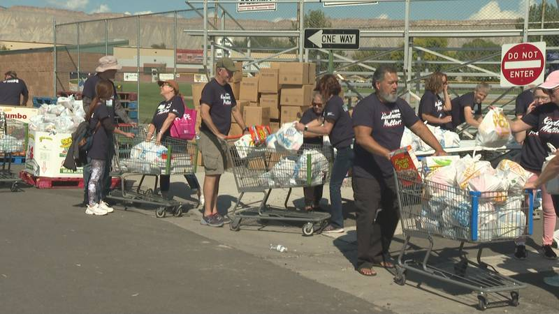 Volunteers gathered groceries at the Convoy of Hope event in Grand Junction, Colo. on Oct. 2,...