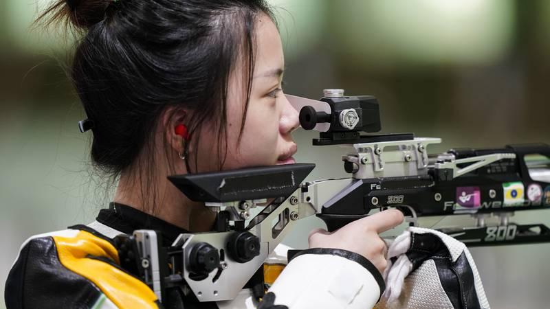 Qian Yang, of China, practices at the Asaka Shooting Range ahead of the 2020 Summer Olympics,...
