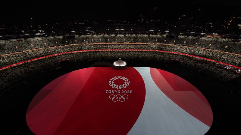 The floor of Olympic Stadium is lit before the start of the opening ceremony at the 2020 Summer...