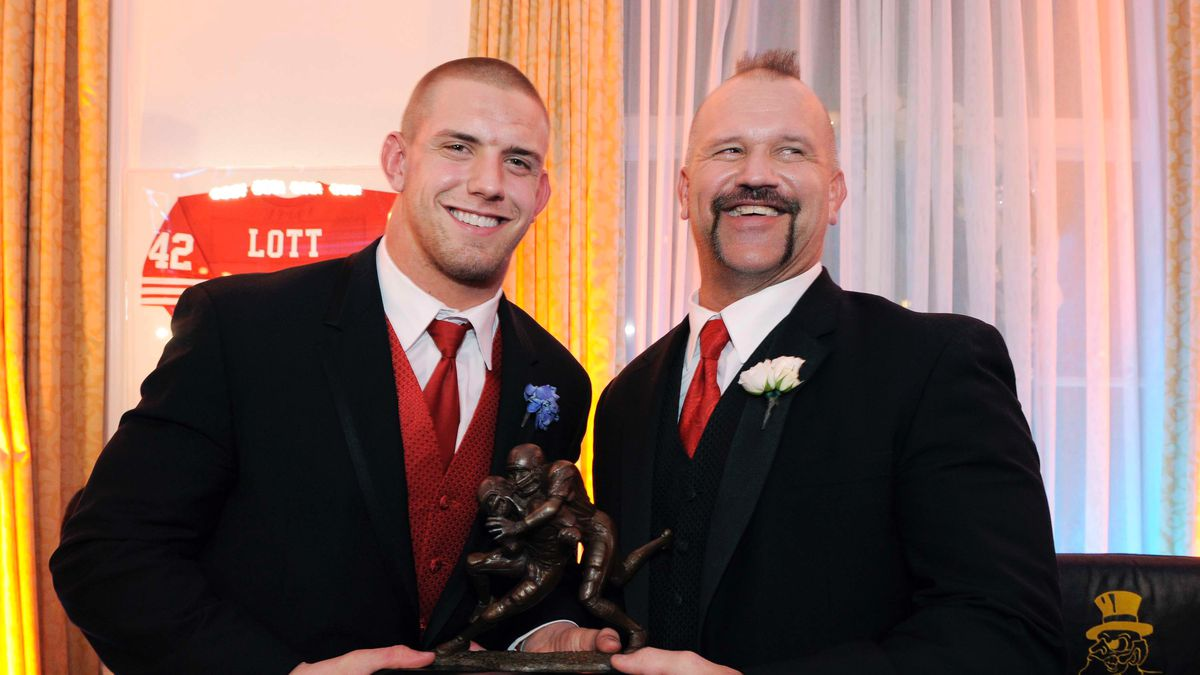 FILE - In this Dec. 14, 2008 file photo of James Laurinaitis, of Ohio State, left, poses with his father Joe Laurinaitis after being awarded The Lott Trophy in Newport Beach, Calif. Joe Laurinaitis knew his middle child was bound for greatness right about the time he saw the 12-year-old doing piledrivers and choke-slamming his younger sister out on the family's backyard trampoline. Now James Laurinaitis is ready to follow in his dad's footsteps as a professional athlete, only in the NFL instead of the WWE.