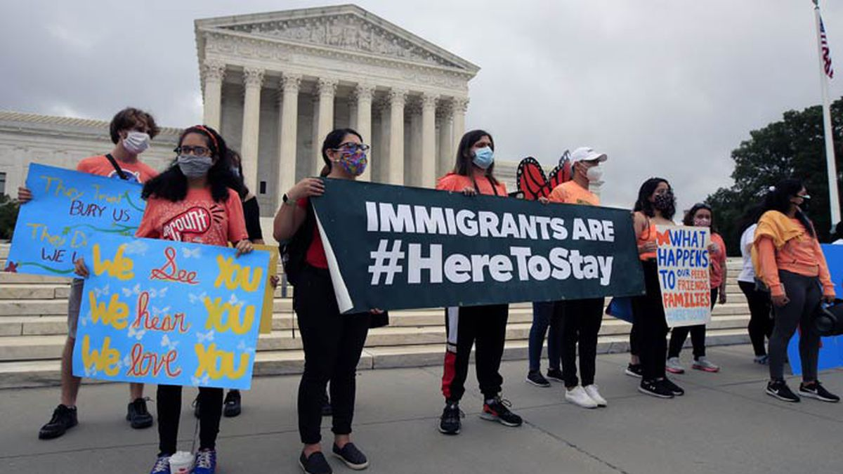 Deferred Action for Childhood Arrivals (DACA) students celebrate in front of the Supreme Court after the Supreme Court rejected President Donald Trump's effort to end legal protections for young immigrants, Thursday, June 18, 2020, in Washington. (AP Photo/Manuel Balce Ceneta)