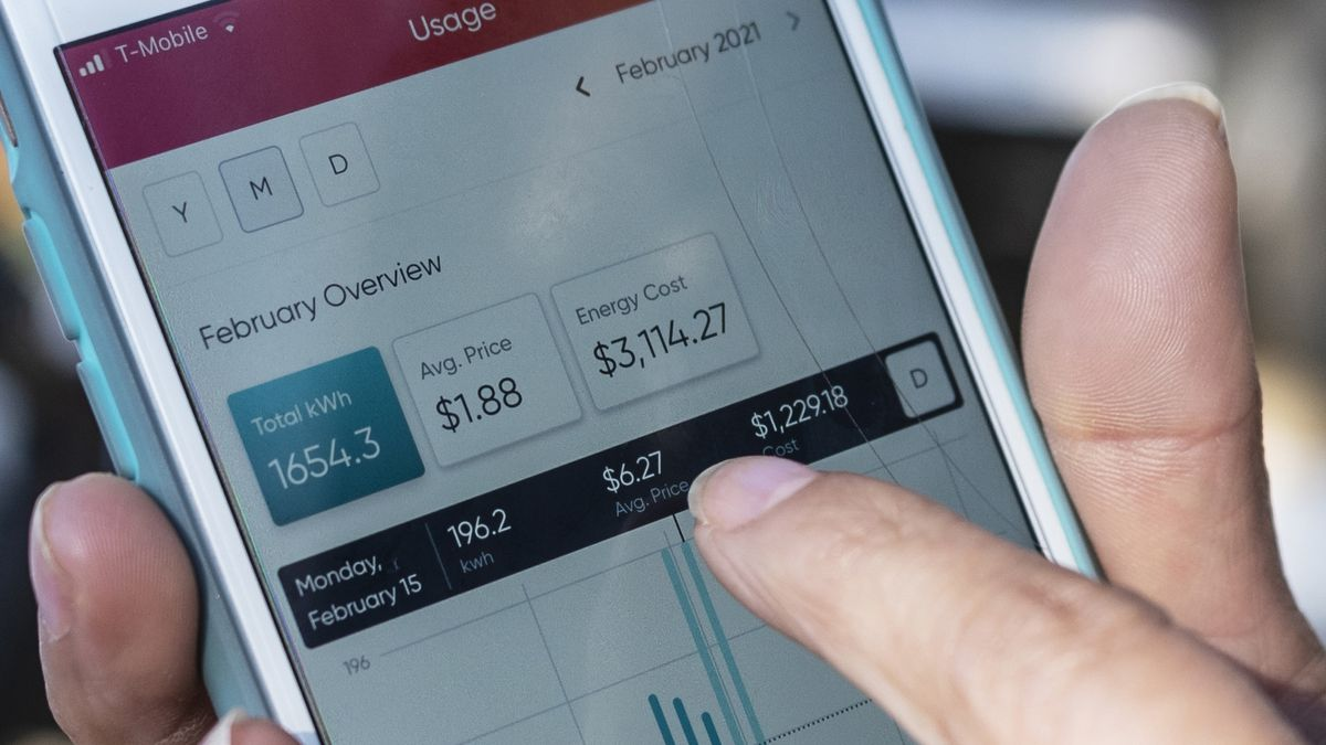 Ivet Cantu, 45, points to her electricity bill from Griddy energy on an app showing her energy...