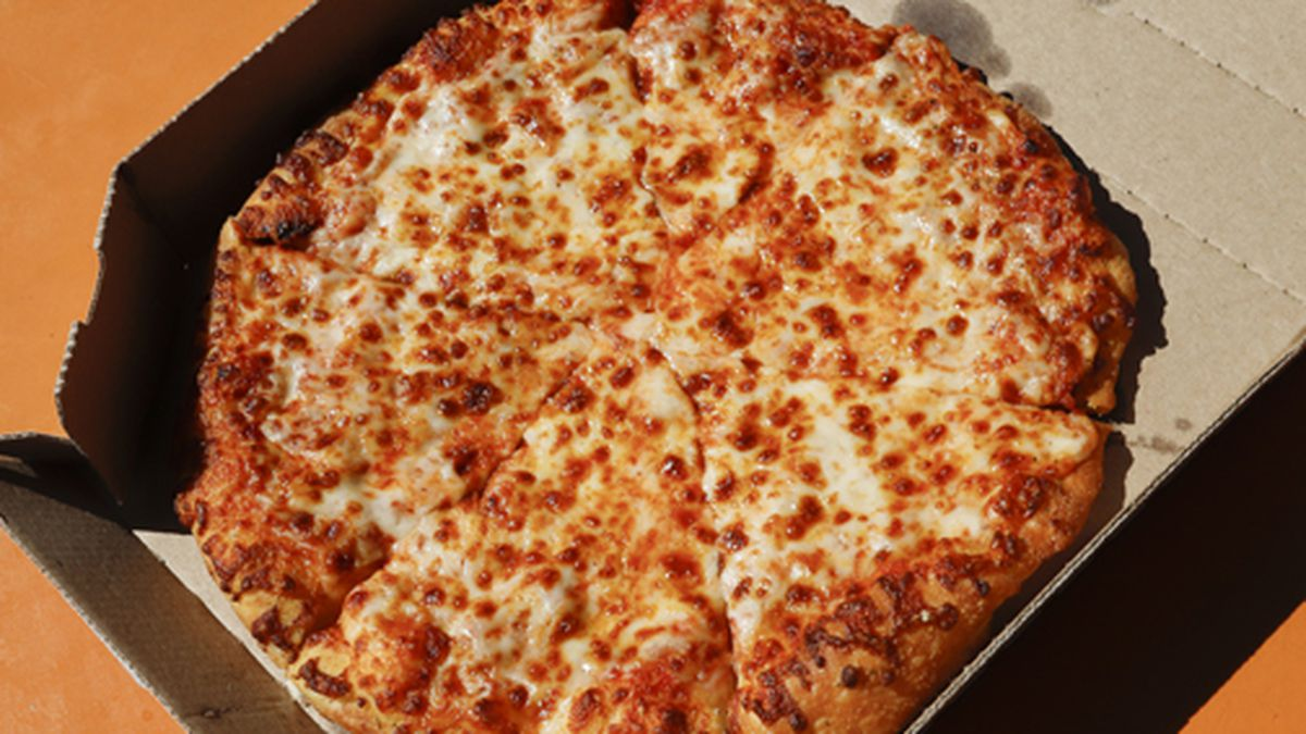 This is a small Domino's pizza made in a Domino's Pizza shop in downtown Pittsburgh on Monday, July 15, 2019. (AP Photo/Gene J. Puskar)