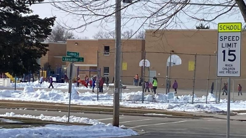 A group of kids play outside, on the playground, at an Appleton Elementary school.