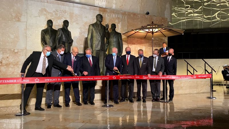 Members of the Dwight D. Eisenhower Memorial Commission cut the ribbon at the new memorial.