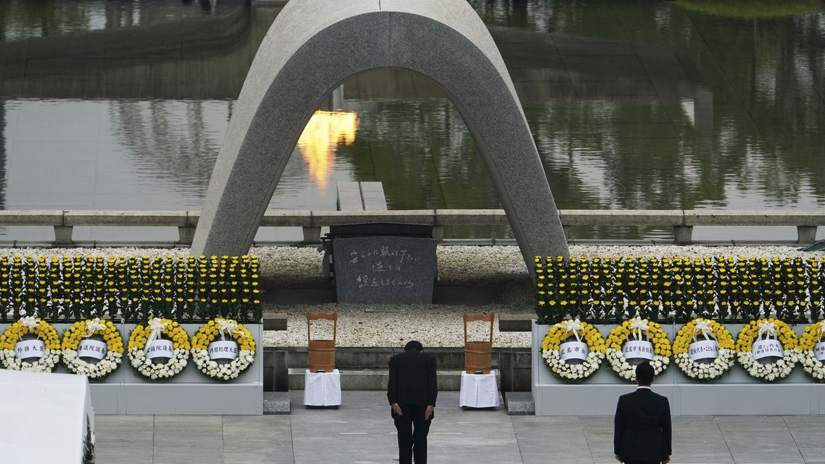 Japanese Prime Minister Shinzo Abe bows in front of Hiroshima Memorial Cenotaph during a ceremony to mark the 75th anniversary of the bombing at the Hiroshima Peace Memorial Park Thursday, Aug. 6, 2020, in Hiroshima, western Japan. (