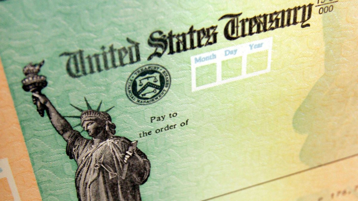 FILE - This May 8, 2008, file photo shows blank checks on an idle press at the Philadelphia...