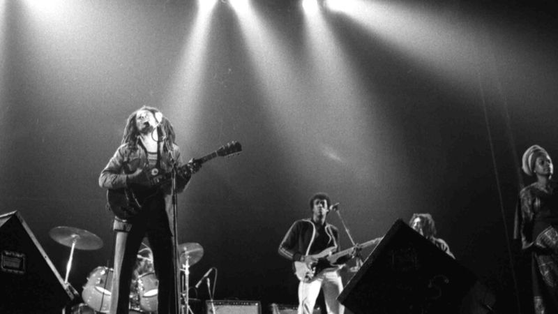 Jamaican Reggae singer Bob Marley and his backing group The Wailers perform in front of an...