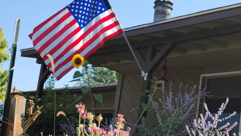 The Redlands Lion's Club members and volunteers placed flags out to commemorate Labor Day