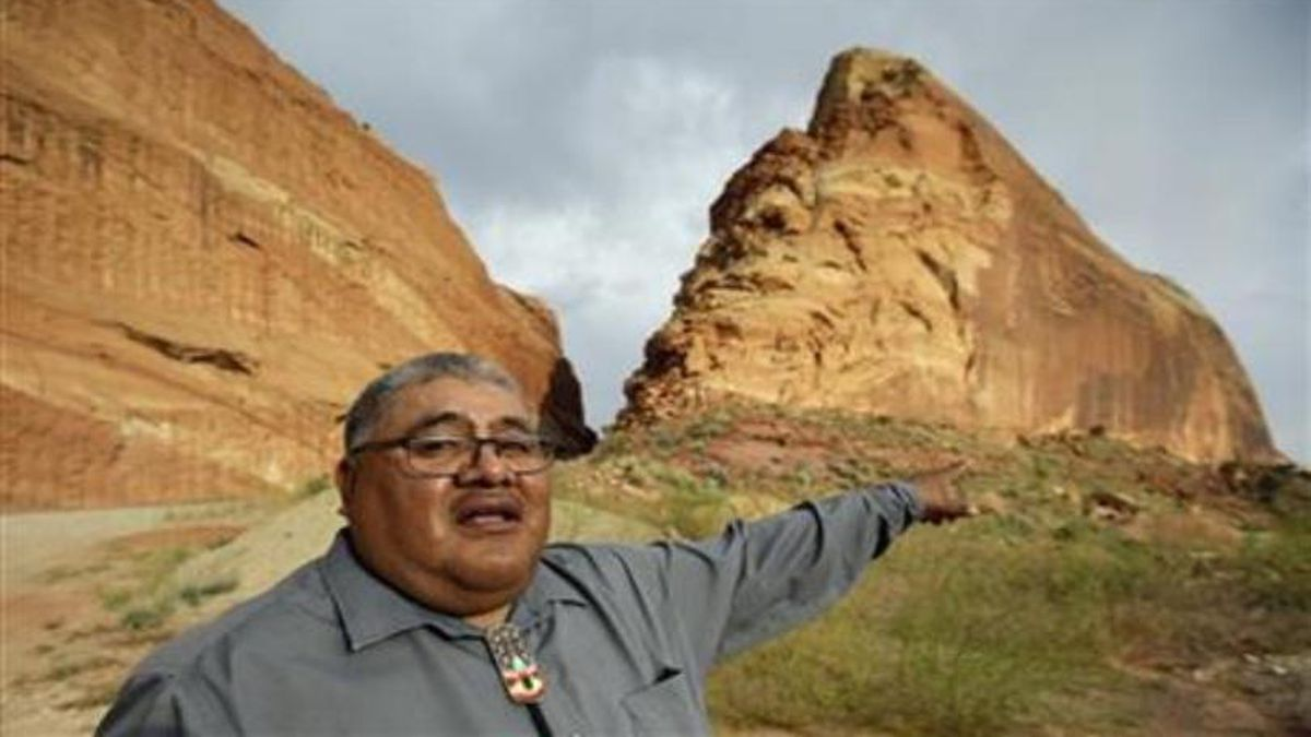 Malcolm Lehi, a Ute Mountain Tribal Commissioner points to a rock formation near Blanding,...
