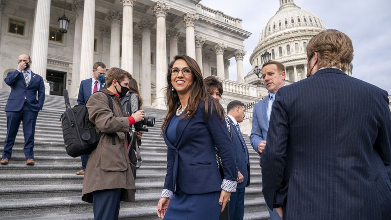 Rep. Lauren Boebert, R-Colo., center, smiles after joining other freshman Republican House...