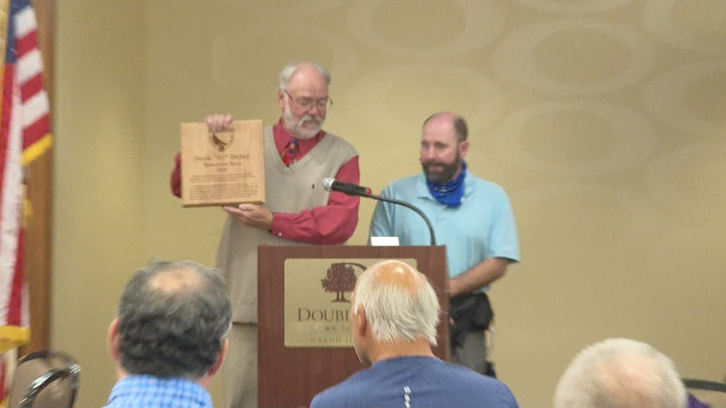 Plaque award given to DJ Dickey at the podium during Tuesdays Hometown Hero event