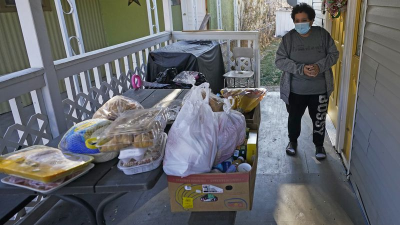 Evelyn Maysonet looks at the food delivery from the Weber-Morgan Health Department Tuesday,...
