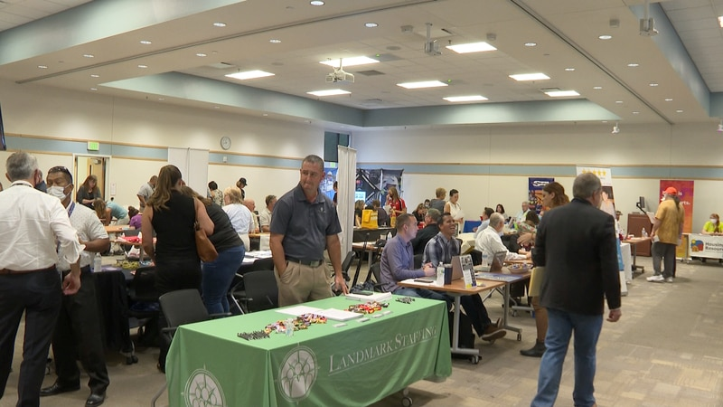 Mesa County Workforce holding job fair at main building with the public looking at different...