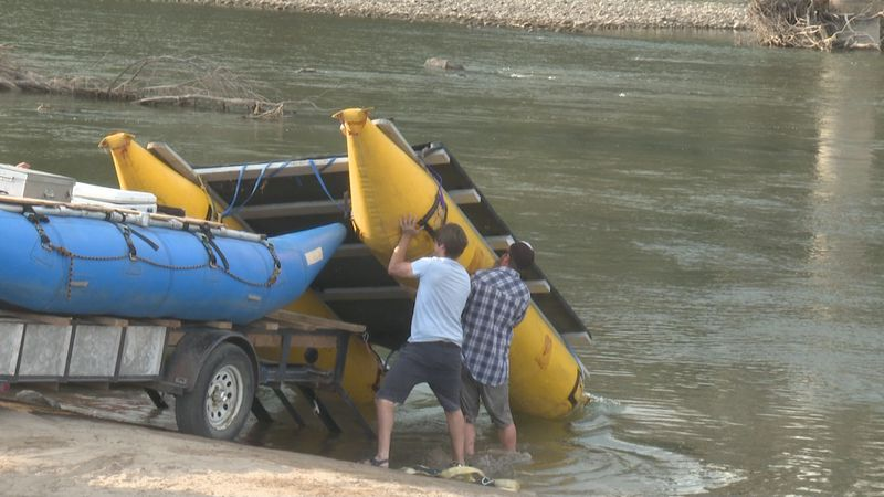 Volunteers gather to help clean the trash out of the Colorado River
