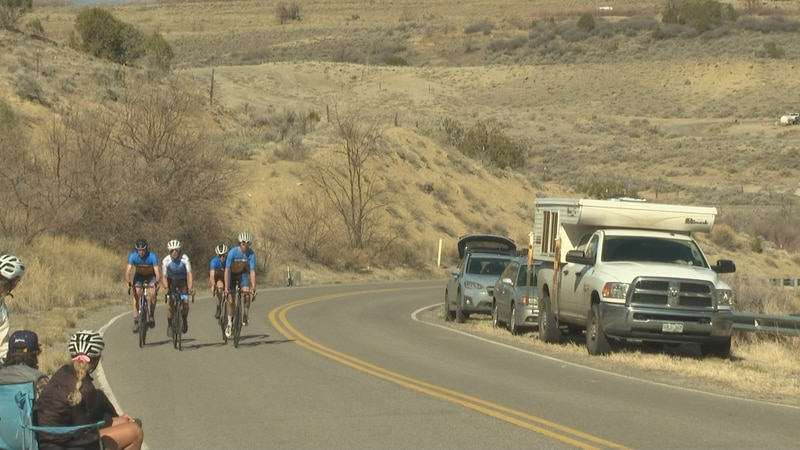 Cyclists along the race course on Divide Rd. in Whitewater, Colo.