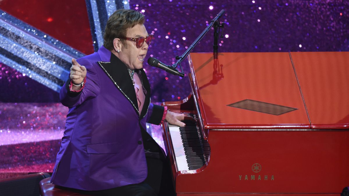 "FILE - In this Feb. 9, 2020 file photo, Elton John performs ""(I'm Gonna) Love Me Again,"" nominated for the award for best original song, from ""Rocketman,"" at the Oscars in Los Angeles."