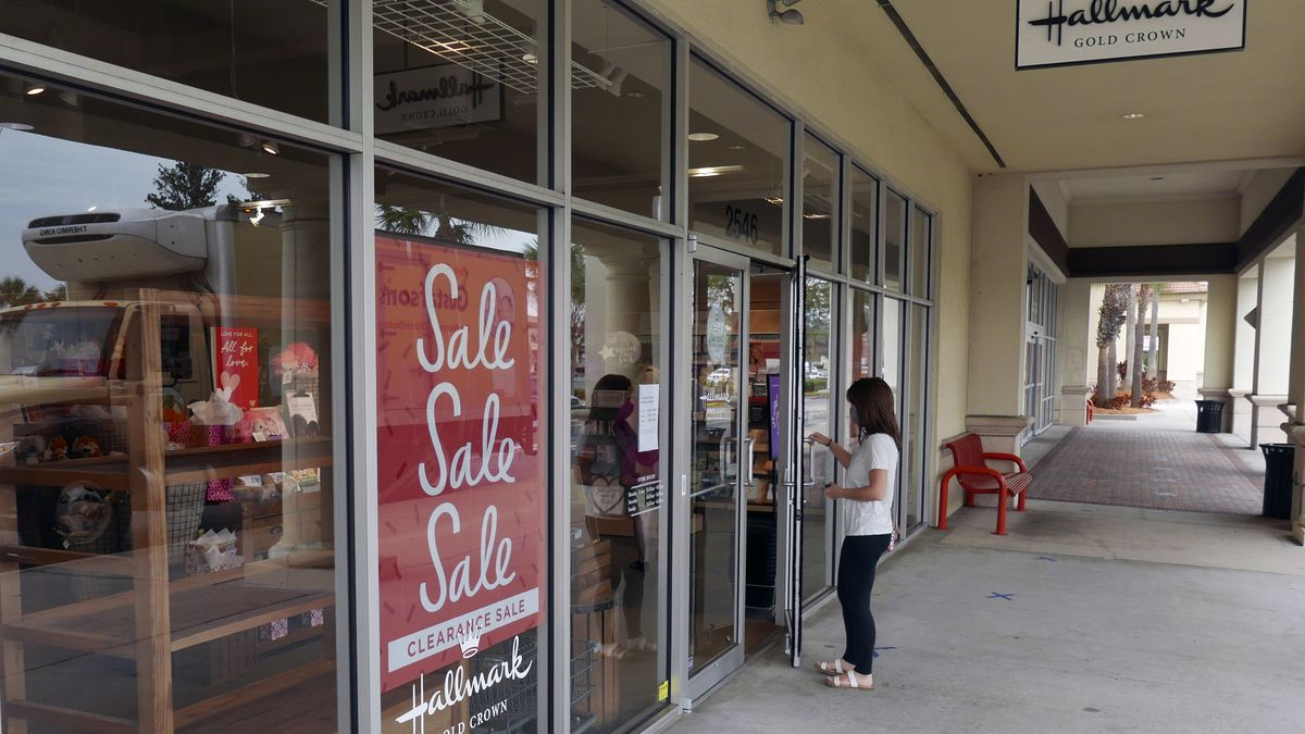 A sale sign is displayed near the entrance of a Hallmark store Tuesday, Jan. 12, 2021, in...