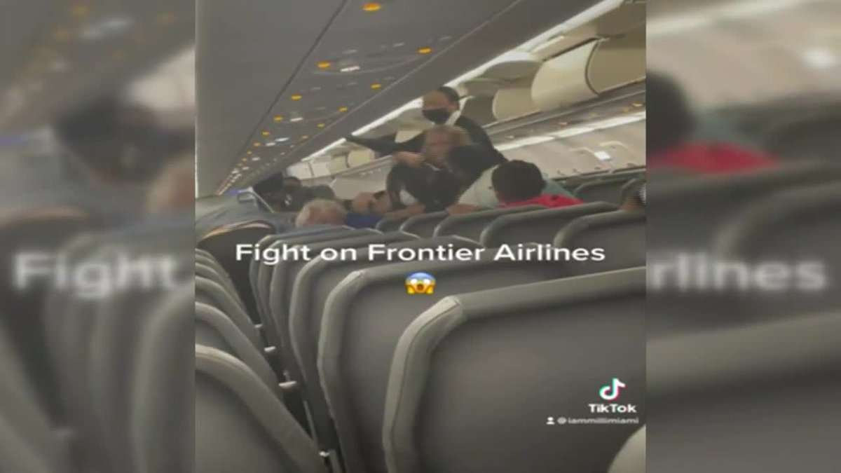 Passenger says brawl caught on video on Frontier Airlines flight was racially motivated.