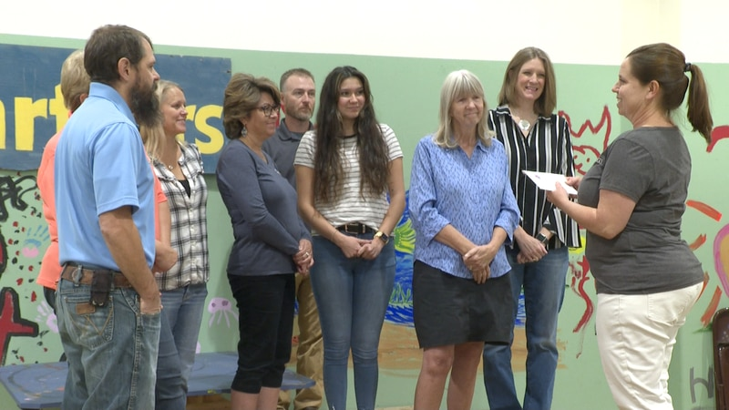Women's Giving Club giving check to Mesa County Partners